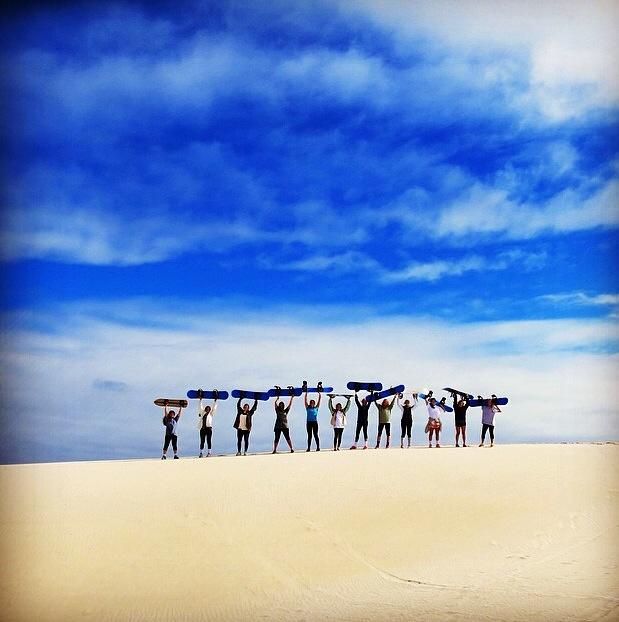 ONE OF TAYLOR'S FAVORITE PICTURES FROM HER DIRECT TRIP -- SHE AND HER FRIENDS SANDBOARDING IN CAPE TOWN!