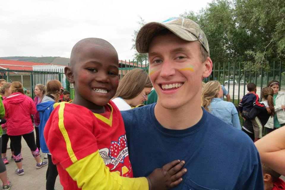 ZACH MAKING FRIENDS WITH THE CHILDREN IN THE TOWNSHIP OF SIR LOWRY'S PASS